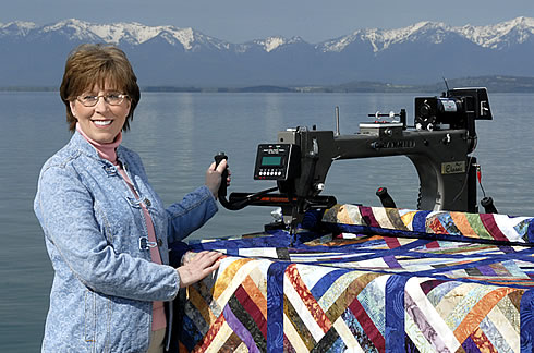 Donita Reeve showing her Gammil Longarm Quilting Machine located on a dock on Flathead Lake.