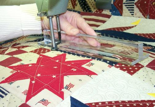 Straight Line Guide, Longarm Quilting Tools shown behind hopping foot.